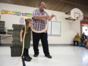 Scarlet Ferguson, Glenwood Heights Primary School kindergartener, lets a reticulated python rest around her neck during Richard Ritchey's Reptile Man presentation at Glenwood Heights Primary School in Vancouver on Dec. 6, 2018.