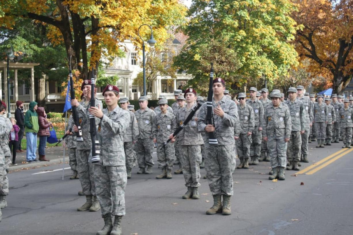 Orchards: John Snyder, Isaiah Hiebert, Dakota Sipe and Ryan Vittitoe of the Prairie High School Armed Drill Team perform at the Fort Vancouver Veterans Day parade.