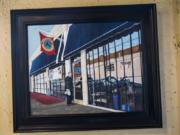 A painting of Woody's Tacos hangs on the wall of the restaurant.