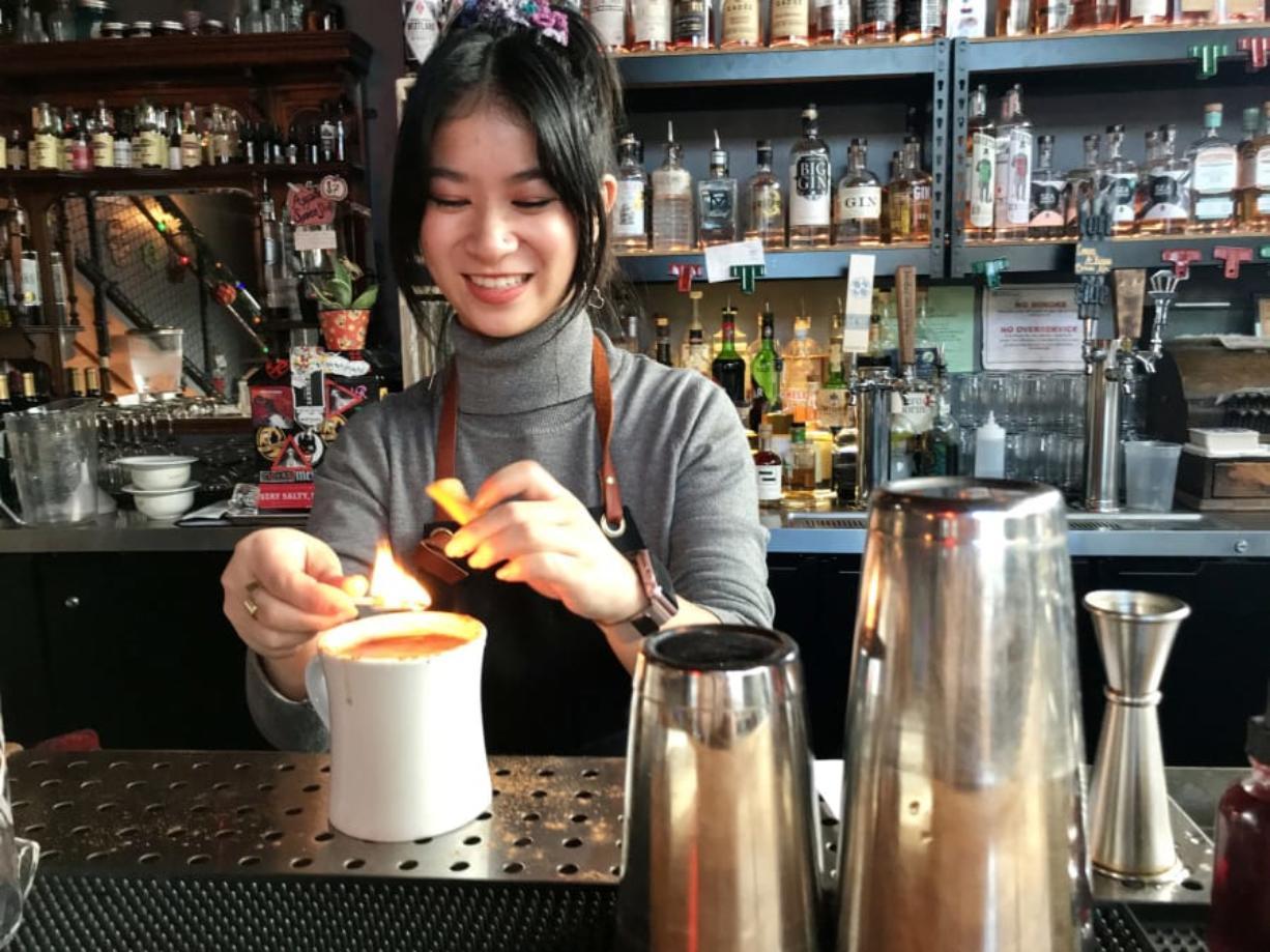 Bartender Juliana Chau prepares Nana's Lovin' at The Grocery Cocktail & Social.