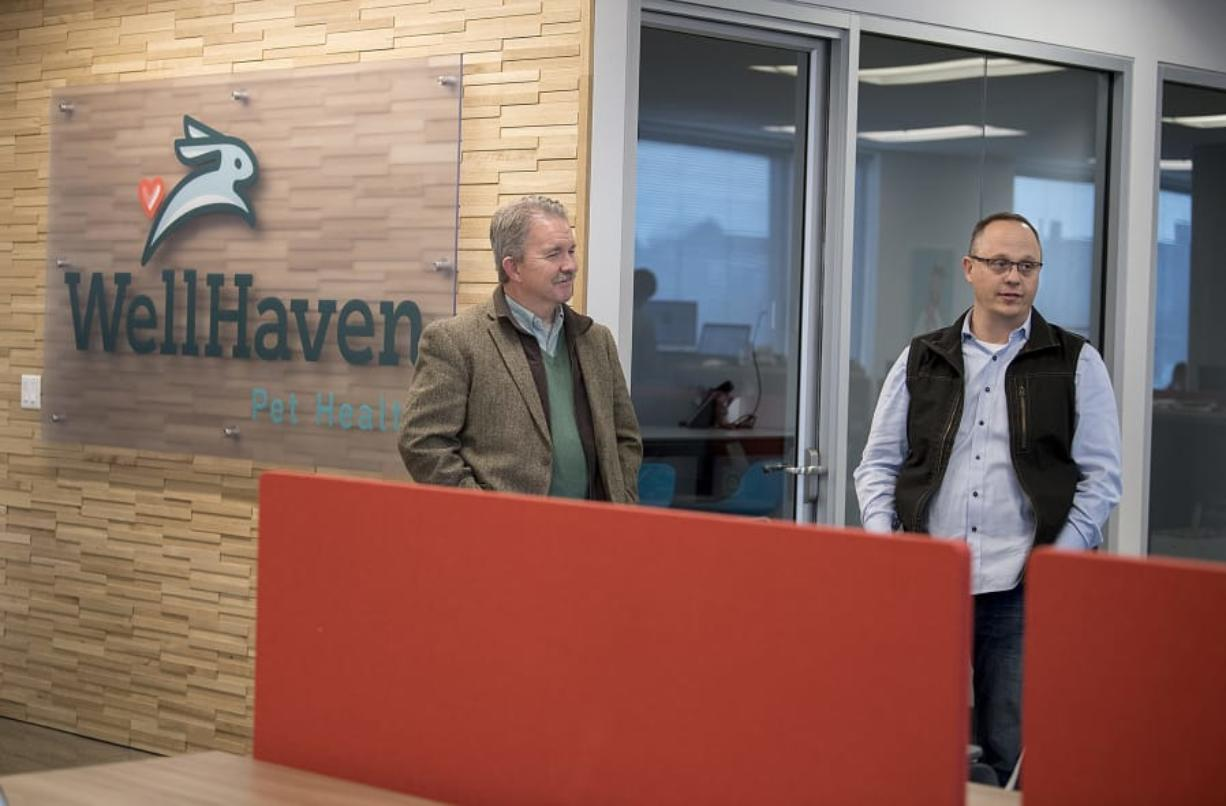 WellHaven Pet Health chief medical officer Bob Lester, left, and chief executive officer John Bork talk about the business at the company's downtown Vancouver corporate office.