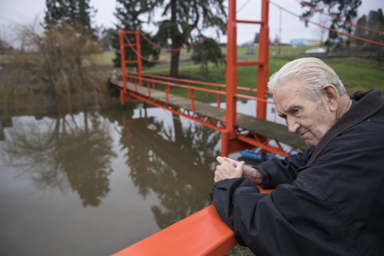 Denny Heasley catches his breath while walking down to the Golden Gate Bridge replica at his home in Ridgefield. The bridge is 110 feet long and 17 feet high. In the decade since the bridge went up, the Heasleys have received a number of visitors.