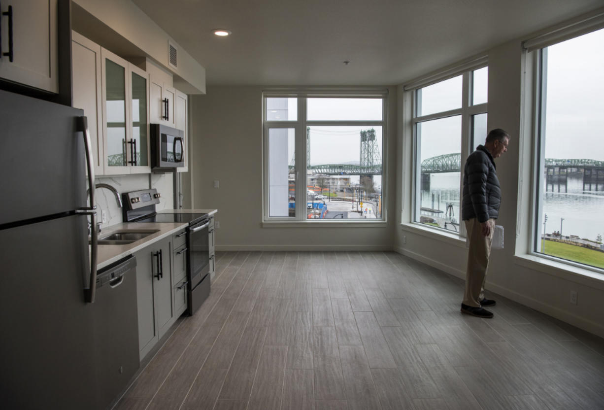 Jim Edwards, Gramor Development project director, views the Columbia River from a one-bedroom apartment at the new Rediviva apartment building at The Waterfront Vancouver. The building opened to tenants last week.