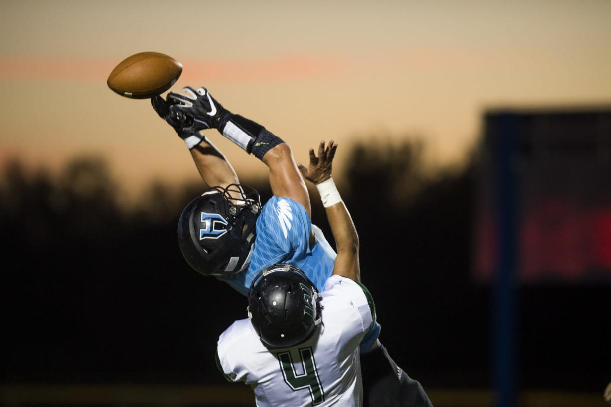 Hockinson's Sawyer Racanelli (11) narrowly misses a catch  during Friday night's game in Hockinson, Wash., on Sept. 28, 2018.