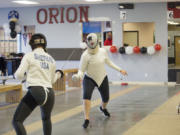 Jazzy Shepard, left, spars with Kaela Meeham at Orion Fencing on Sunday afternoon. Orion Fencing in Orchards held a free open house over the weekend.