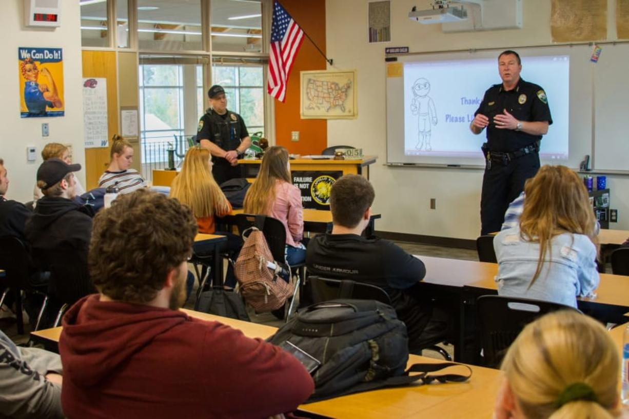 Woodland: Police Chief Jim Kelly and officer Brent Murray visited Katie Klaus' government class at Woodland High School.
