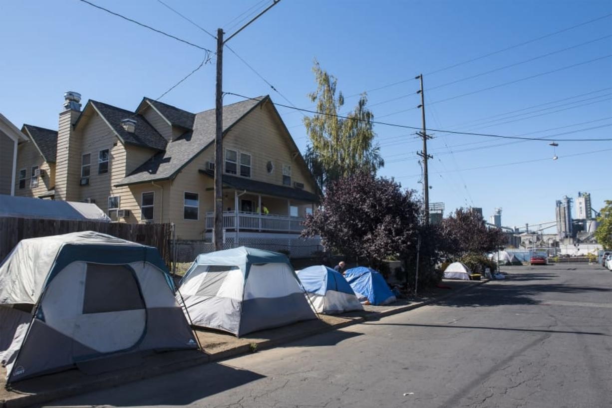 Tents and other make-shift shelters are seen here in front of Share. The new Human Service Facilities Siting ordinance will make it easier for Share to locate additional services in the future.
