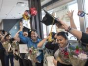 English Under the Arches graduates celebrate following a ceremony on Monday at the McDonald's at 2814 N.E. Andresen Road.