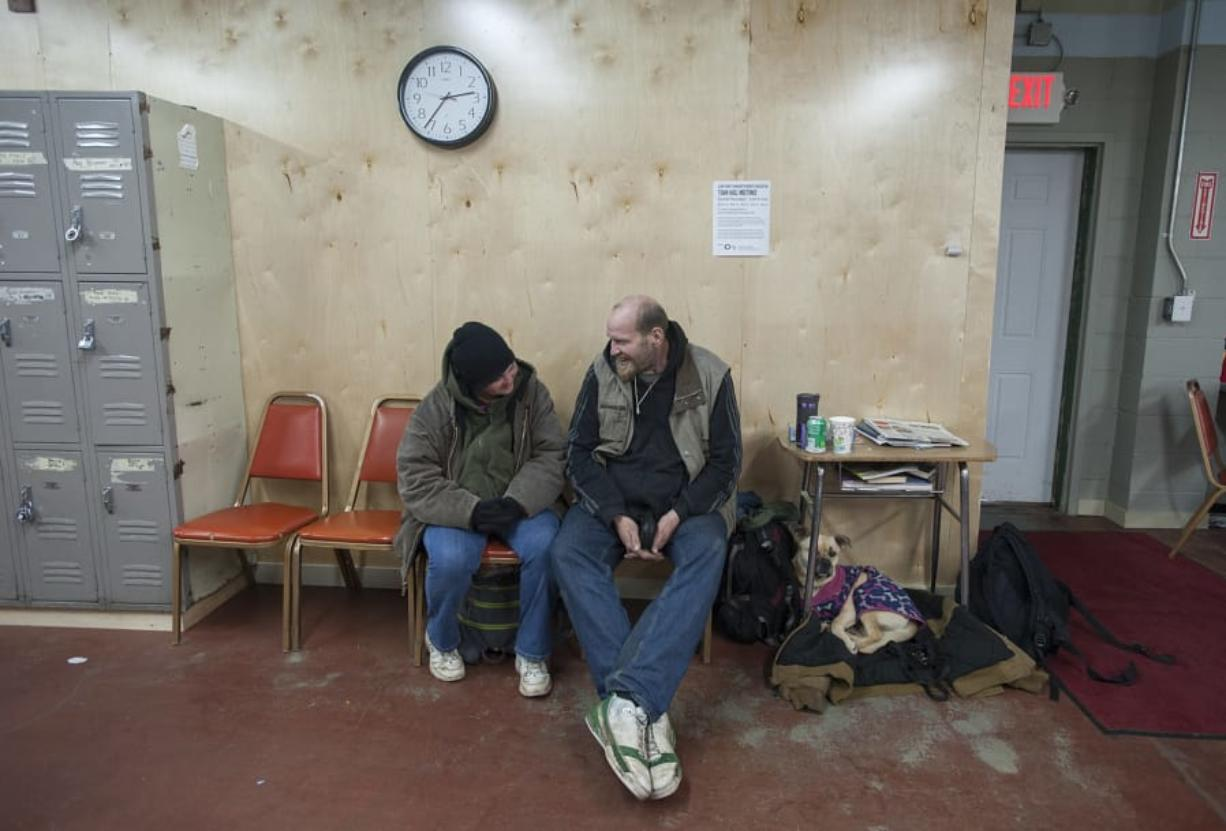 Michael Fugger, right, was among the homeless people who died this year. He's pictured with Heather Gallardo, left, and their dog Chubbs on March 9, 2016, at the former day center in west Vancouver.