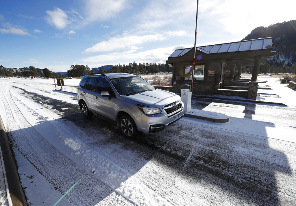motorists glide through the unattended toll booths at rocky mountain national park saturday dec