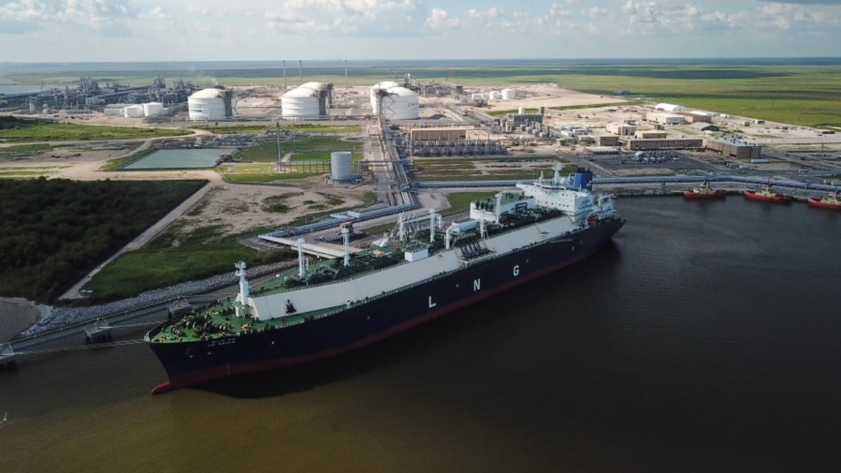 In this July 6, 2018 photo, a carrier ship for liquefied natural gas (LNG) is docked at Cheniere'Äôs Sabine Pass Terminal in Cameron Parish, La. By specifically promoting LNG exports, the U.S. government is helping guarantee the success of a handful of companies _ using taxpayer dollars to boost a nascent industry it also regulates. Houston-based Cheniere has benefited from the government'Äôs LNG push.