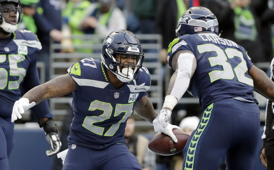 Seattle Seahawks  Mike Davis (27) celebrates his touchdown with Chris  Carson during the 2d65a3342
