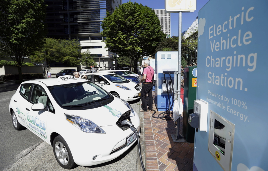 A Line Of Electric Cars And Newly Installed Charging Stations In Front The Portland General
