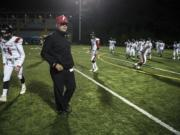 Neil Lomax, Fort Vancouver head coach, runs warm ups before a game in the Kiggins Bowl on Friday night, Oct.