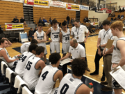 The Skyview basketball team huddles around coach Matt Gruhler during a 68-67 loss to West Linn (Ore.) in the first round of the Les Schwab Invitational.