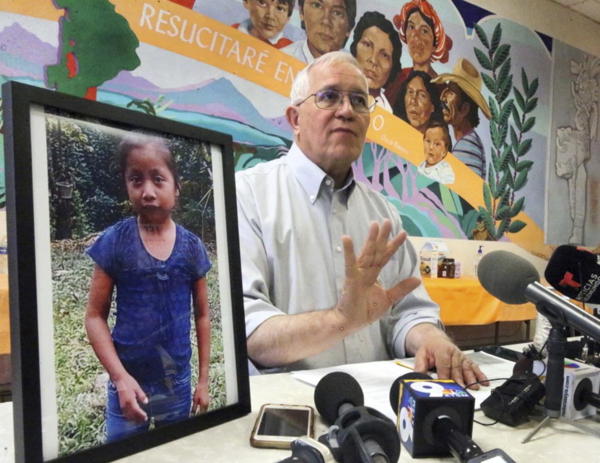 Annunciation House director Ruben Garcia answers questions after reading a statement from the family of Jakelin Caal Maquin, pictured at left, Saturday at a press briefing in El Paso, Texas.