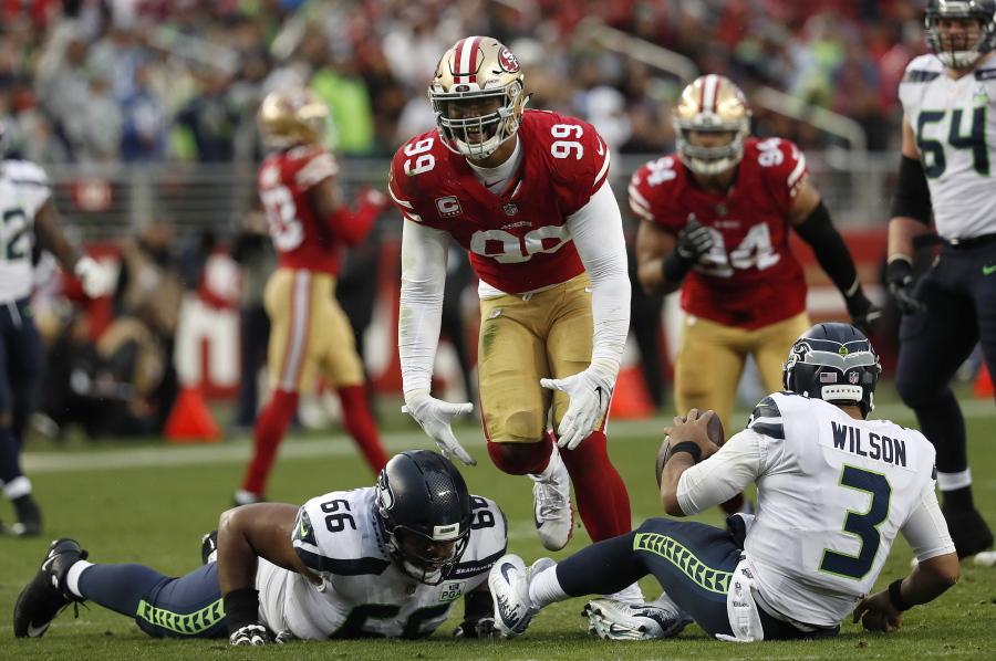 bba84d64bf2 San Francisco 49ers defensive end DeForest Buckner (99) celebrates after  sacking Seattle Seahawks qu