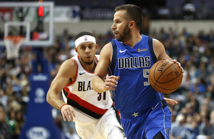 611fb018e209 Dallas Mavericks guard J.J. Barea (5) dribbles past Portland Trail Blazers  guard Seth Curry