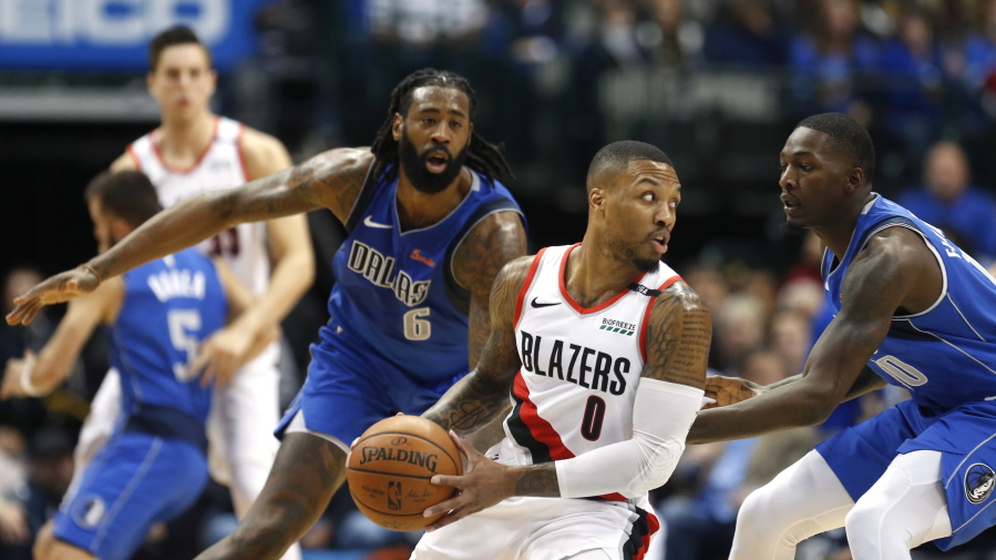 7d672fdf9982 Portland Trail Blazers guard Damian Lillard (0) looks to pass as Dallas  Mavericks DeAndre