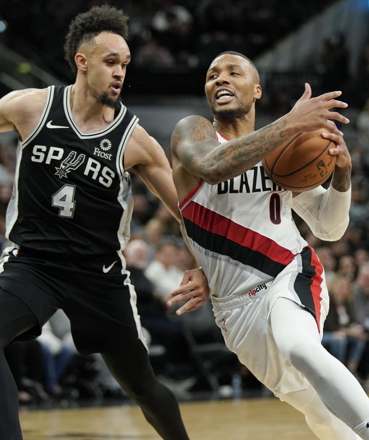26835708aa519 Portland Trail Blazers  Damian Lillard (0) drives around San Antonio Spurs   Derrick
