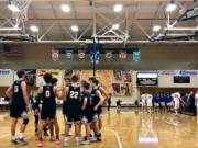 Skyview huddles before taking the court against Barlow (Ore.), a game it won 60-55 on the third day of the Les Schwab Invitational.