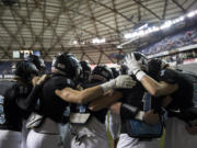The Hawk circle up to pump each other up before the 2A state football championship game against Lynden on Saturday, Dec. 1, 2018, in Tacoma, Wash.