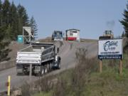 A truck passes a sign for Livingston Mountain Quarry as it enters the facility east of Vancouver on April 26, 2019.