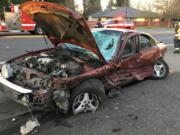 A man driving a red four-door car and a woman driving a black sport-utility vehicle side-swiped while driving in the opposite directions near Northeast 102nd Avenue and Northeast Fourth Plain Boulevard, Vancouver firefighter-paramedic Joe Hudson said.