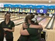 Evergreen's Kerissa Andersen (right) and Dakota O'Neil embrace after placing first and second at the 3A state bowling championships on Thursday.