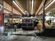 An SUV sits stopped amid what was part of Camas Produce's fruit selection after its driver, whom the Camas Police Department says was driving while impaired, smashed through the front of the store Thursday evening. No one was injured.