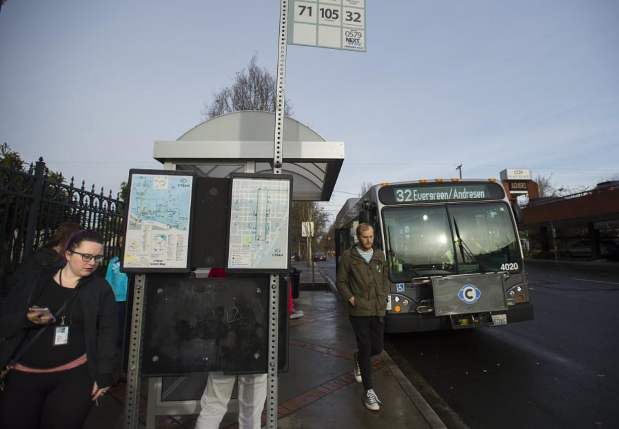Kourtney Foley of Vancouver, left, joins fellow C-Tran riders as she makes her way off a bus in downtown Vancouver. Passengers can pay their fares in a variety of ways, but no change is given.