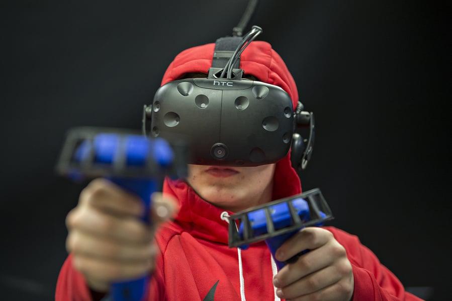 "66b1231b13d7 Ricky Watkins of Illinois takes aim while playing the zombie shooter VR  game ""Arizona Sunshine"