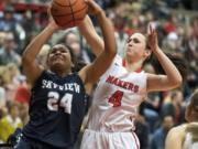 Camas' Regan Cooke (4) gets position to block the shot of Skyview's Mikelle Anthony (24) during Friday's 4A Greater St. Helens League game at Camas High School.