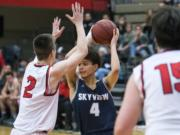 Skyview's Squeeky Johnson (4) looks to pass during Friday night's game against Camas at Camas High School on Jan. 11, 2019.