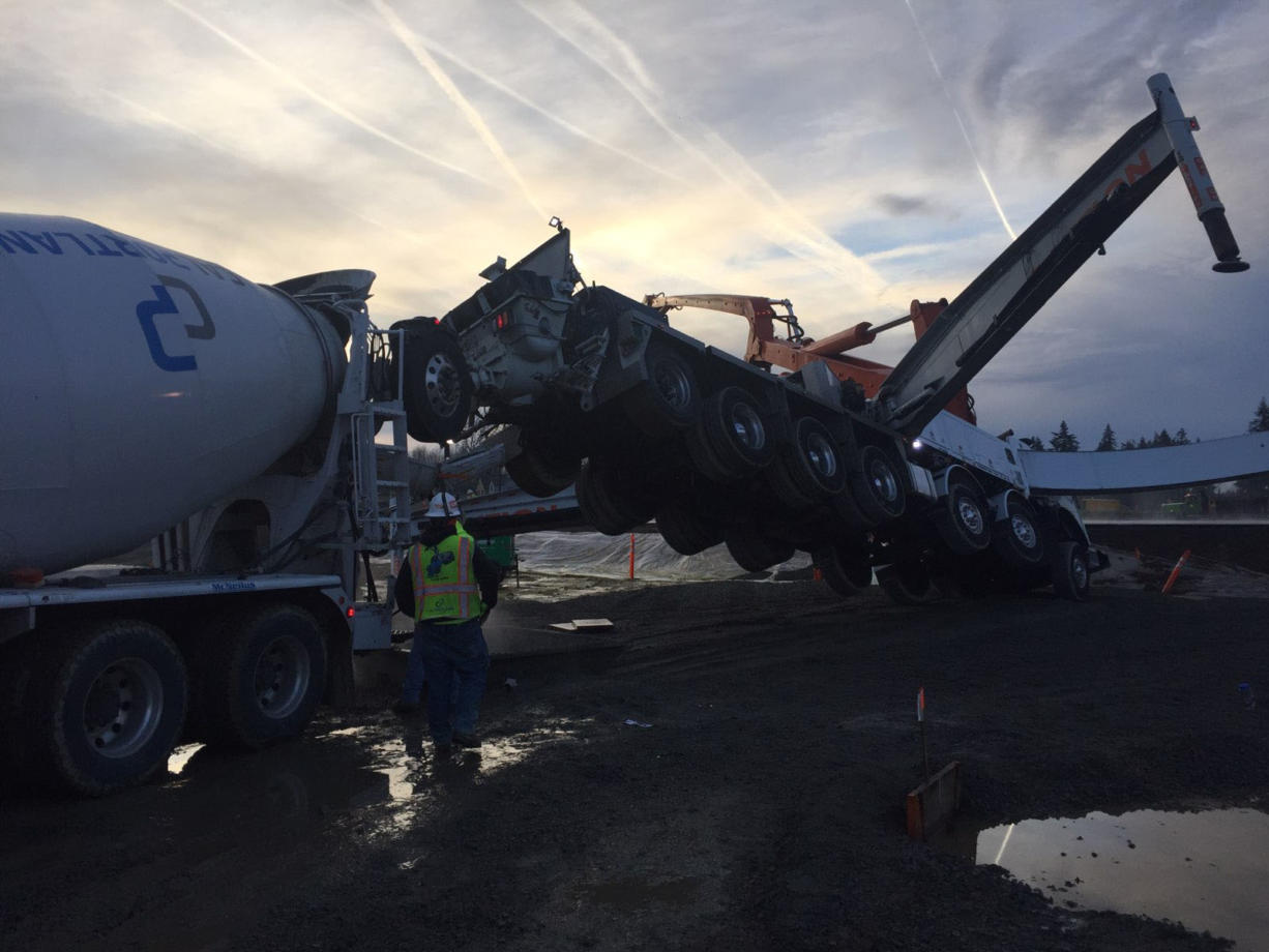 The driver of a concrete mixer truck was seriously injured Friday morning after a concrete pump truck tipped, launching him off of a ladder and into nearby equipment, at a construction site in the 7100 block of South 10th Street in Ridgefield.