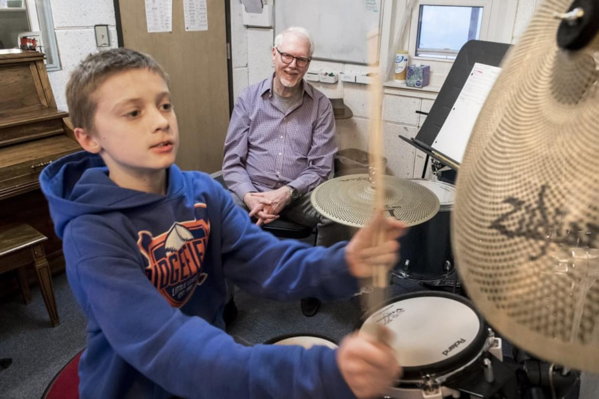 """D.J. Trussler, 12, plays """"The Shortest Straw"""" by Metallica on the drums while Jim Pitts, drum instructor at the Opus School of Music, watches during a lesson at the Ridgefield location, 414 Pioneer St."""