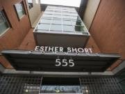A sign for Esther Short Commons greets visitors on its Eighth Street side.