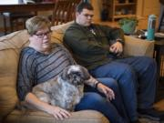 Jamie Hansen and her son Ryan, 15, talk about their experience with high medical bills at their home in La Center.