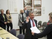 The Clark County Council watches Gary Medvigy take his oath of office after being appointed the newest member of the council Tuesday at the Public Service Center.