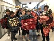 Brush Prairie: Hockinson Middle School students hosted their first Community Service Day in December, and some students turned fleecy fabrics into 37 blankets, which were donated to Vancouver's Winter Hospitality Overflow shelter.