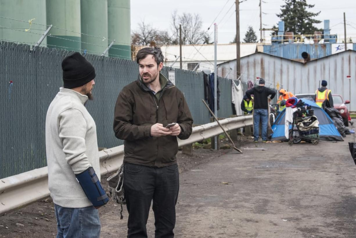William Silva, left, speaks to Blake Hauser, an outreach case manager with Share, in January for the annual Point in Time count. By midmorning Hauser said he'd seen many familiar faces as he helped conduct a census of Clark County's homeless population.