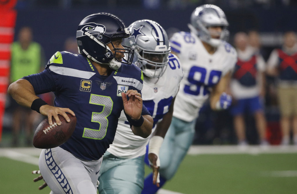 Seattle Seahawks quarterback Russell Wilson (3) runs out of the pocket  against the Dallas 5de3d95a8