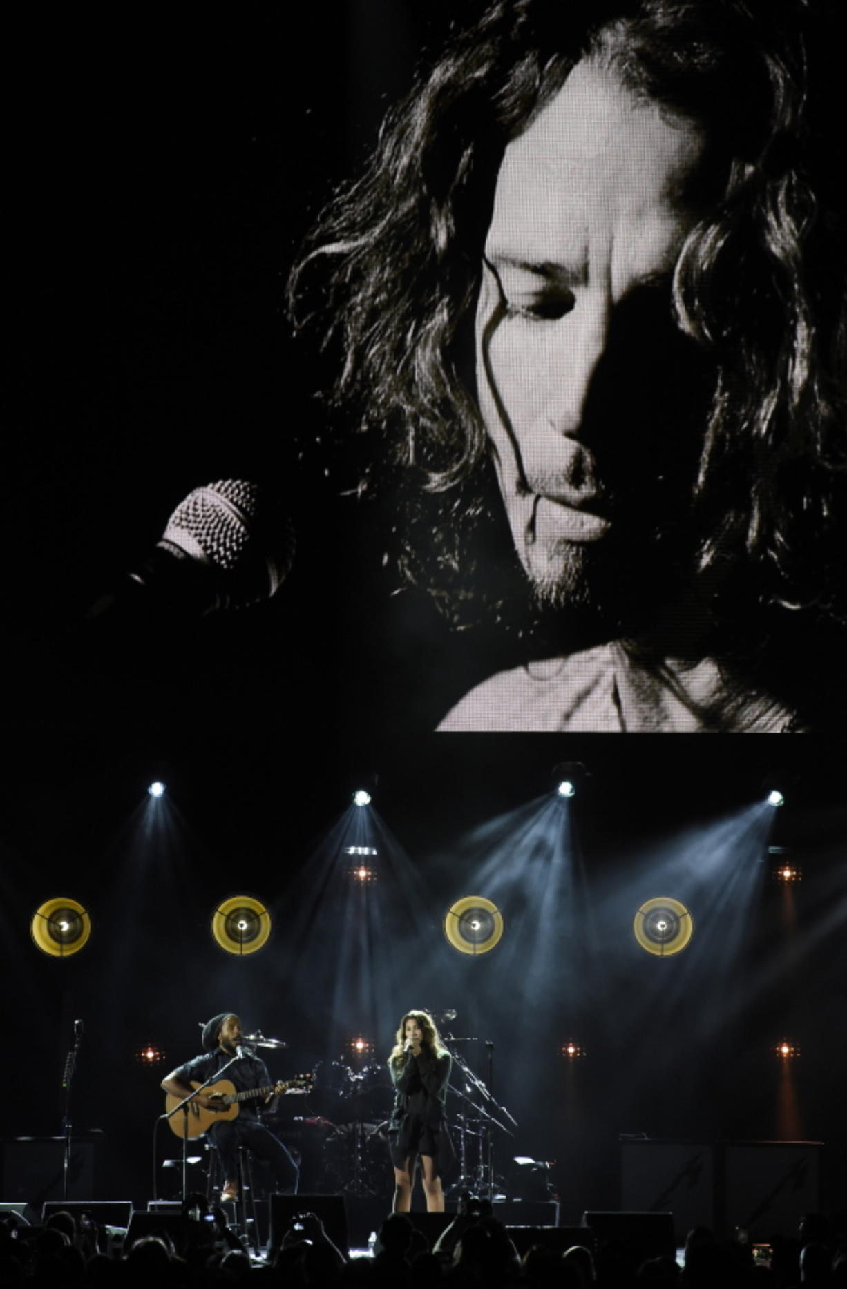 """Toni Cornell, daughter of the late singer Chris Cornell, performs with Ziggy Marley, bottom left, underneath a video image of her father during """"I Am The Highway: A Tribute to Chris Cornell"""" at The Forum, Wednesday, Jan. 16, 2019, in Inglewood, Calif."""