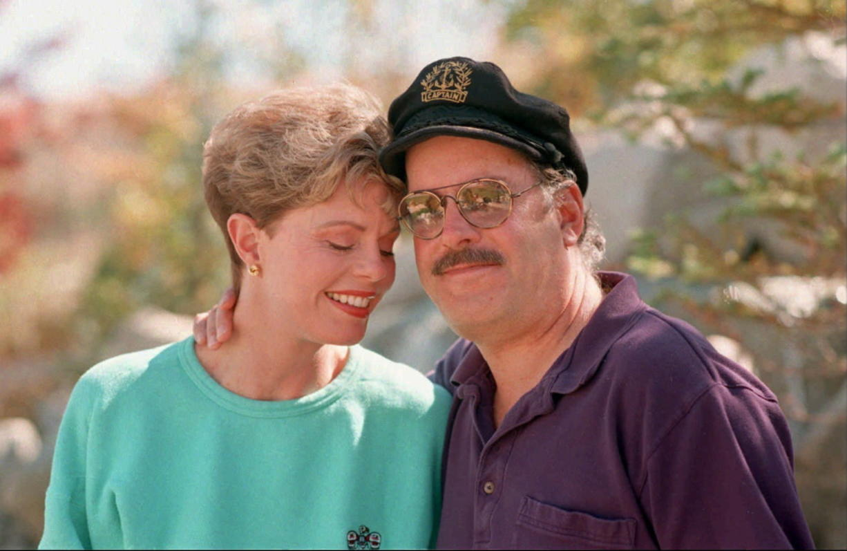 FILE-This Oct. 25, 1995 file photo shows Toni Tennille, left, and Daryl Dragon, the singing duo The Captain and Tennille, posing during an interview in at their home in Washoe Valley, south of Reno, Nev. Dragon died early Wednesday, Jan. 2, 2019 in at a hospice in Prescott, Ariz. Spokesman Harlan Boll said he was 76 and died of renal failure. His former wife and musical partner, Toni Tennille, was by his side. (AP Photo/David B.