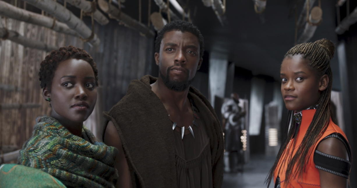 """FILE - This file image released by Disney shows Lupita Nyong'o, from left, Chadwick Boseman and Letitia Wright in a scene from """"Black Panther."""" The producers behind hits """"Black Panther,"""" """"Crazy Rich Asians,"""" """"A Star Is Born"""" and """"Bohemian Rhapsody"""" are among the 10 nominees for the top prize at the Producers Guild Awards announced Friday, Jan. 4, 2019."""