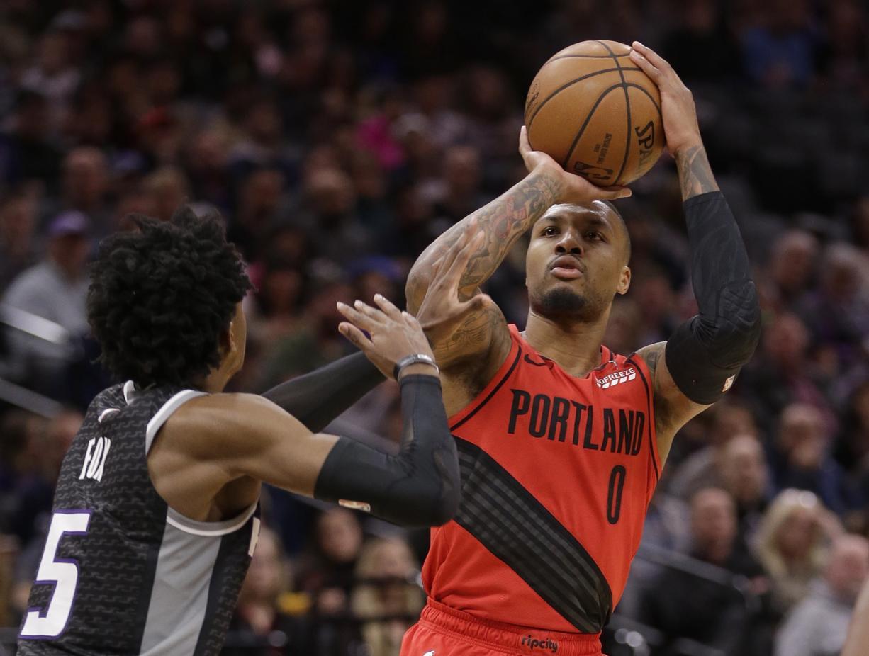 Portland Trail Blazers guard Damian Lillard shoots over Sacramento Kings guard De'Aaron Fox (5) during the second half of an NBA basketball game Tuesday, Jan. 1, 2019, in Sacramento, Calif.