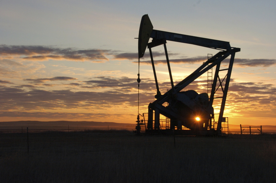 A Whiting Petroleum Co. pump jack pulls crude oil from the Bakken region of the Northern Plains on Nov. 6, 2013, near Bainville, Mont. Associated Press files