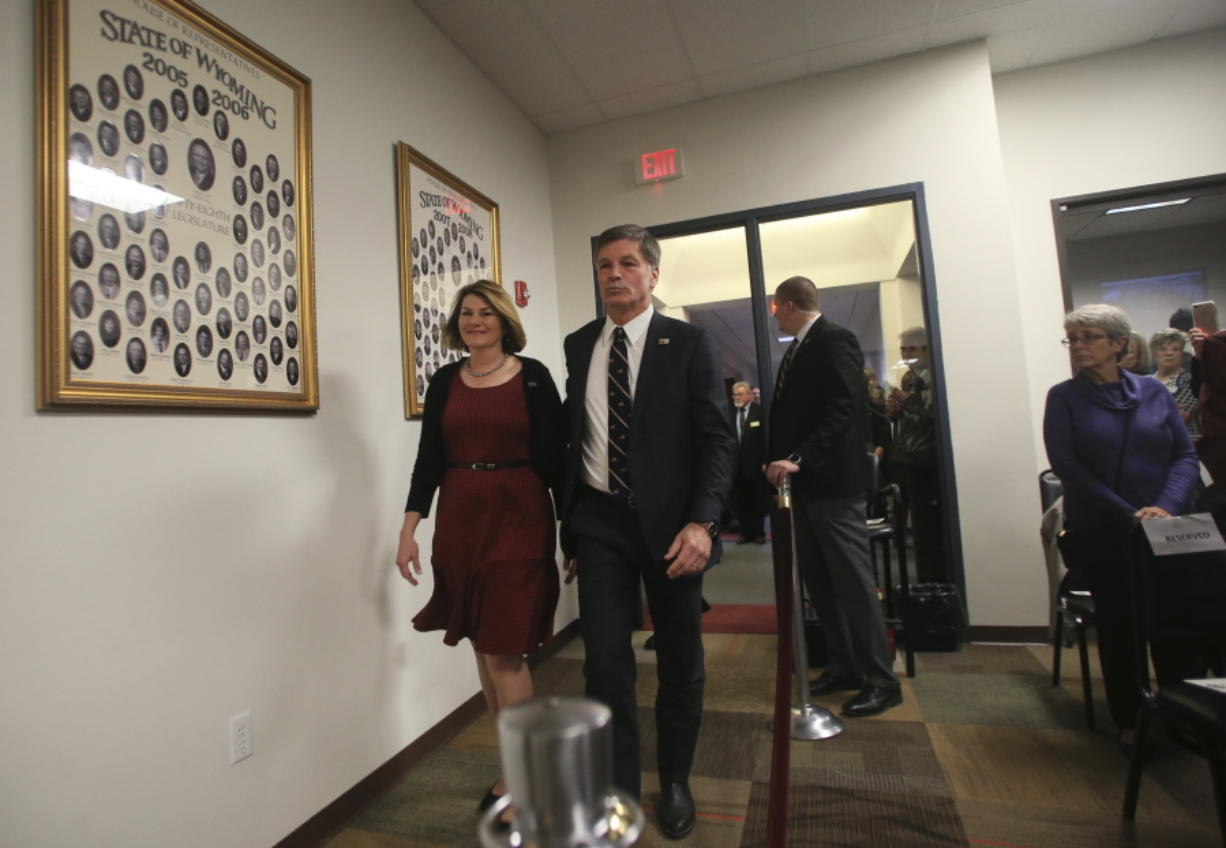 Wyoming Gov. Mark Gordon enters the House Gallery with his wife, first lady Jennie Gordon, during the second day of the 65th Wyoming Legislature's 40-day general session Wednesday, Jan. 9, 2019, in Cheyenne, Wyo.