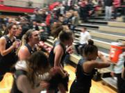 The Union girls basketball team celebrates while exiting the floor after a 53-44 win at Camas on Friday night.