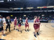 The Prairie girls basketball team walks off the ShoWare Center floor after beating No. 5-ranked West Seattle 58-50 in the King Showcase on Monday.